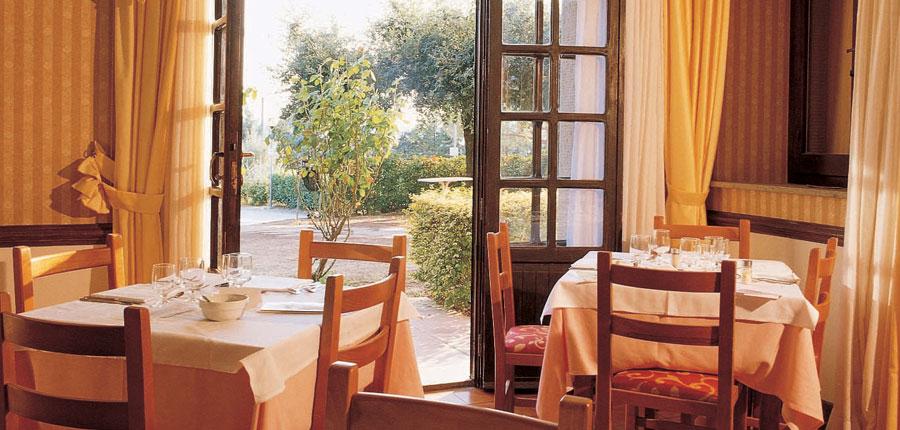 Club Hotel Villa Paradiso, Lake Trasimeno, Italy - restaurant overlooking garden.jpg